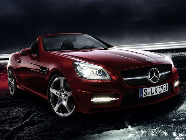 Red Mercedes SLK 55 AMG, an open-top sports car